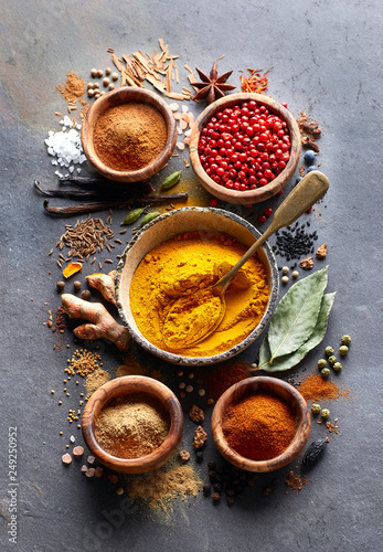 Spices on black in closeup © Dionisvera