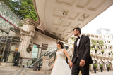 Wedding couple posing in new mall in Hong Kong