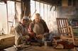 Two craftsmen in their craft workshops work metal parts