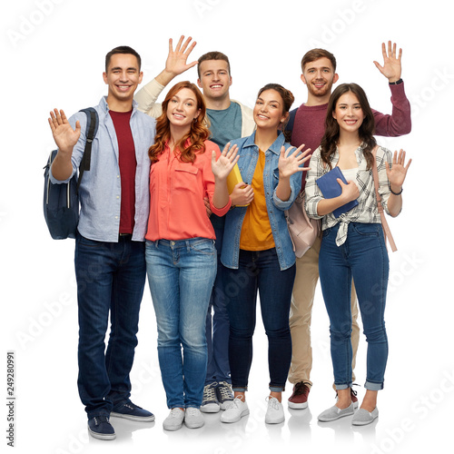 education, high school and people concept - group of smiling students with books waving hands over white background - 249280991