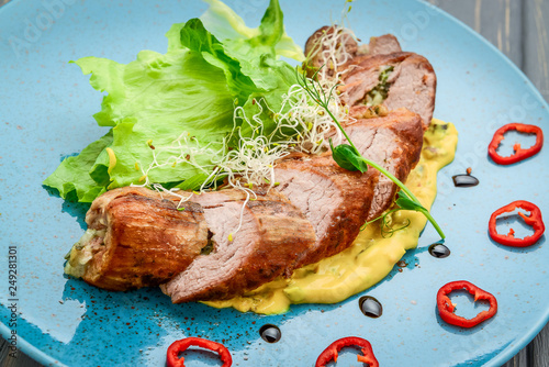Baked beef stuffed with mushrooms and herbs with pumpkin puree and salad - 249281301