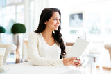 Beautiful woman looking at menu - 249284984