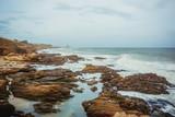 The rocky shore of the Indian Ocean in the city of Kanyakumari. India - 249292137
