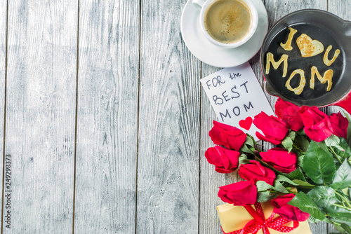 Leinwanddruck Bild Mother's day greeting background concept, with red rose flowers, greeting card creative pancakes for best mom, i love mom, and coffee mug, wooden background copy space