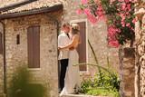 Beautiful wedding couple posing in old city - 249303522