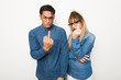 Leinwanddruck Bild - Young couple with glasses making horn gesture