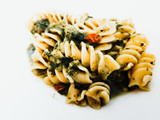 Pasta with pesto sauce and nuts on a the table - 249333905