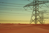 Electricity or  high voltage power lines in dessert at sunset - 249335990