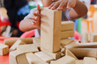 child playing with wooden building blocks - 249350139