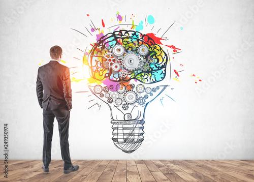 Leinwanddruck Bild Businessman looking at idea sketch