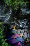 Rock climbing, bouldering. Male athlete on beautiful rocks. Active healthy - 249352780