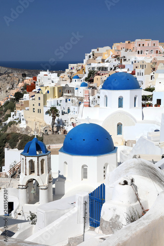 Amazing panorama view with white houses and blue domes in Oia village on Santorini island, Greece