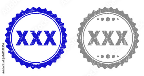 Grunge XXX stamp seals isolated on a white background. Rosette seals with grunge texture in blue and gray colors. Vector rubber stamp imitation of XXX caption inside round rosette.