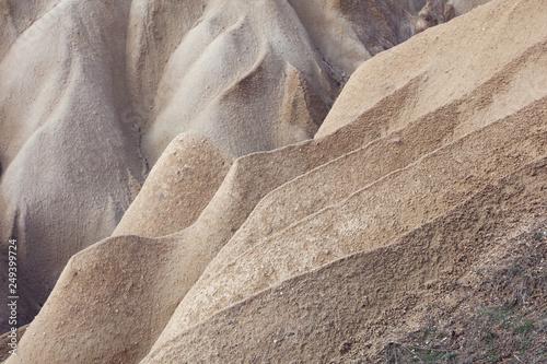 Leinwanddruck Bild Background from Sand dunes landscape,Volcanic rock formations, Cappadocia.