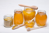 honey dipper and honey in jar on white background