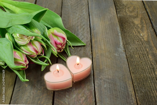 365/5000 tulips and candles in the shape of hearts for a romantic evening © rosali