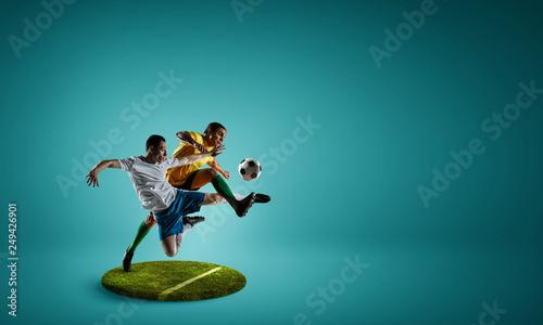 Leinwanddruck Bild Soccer players on round pedestal. Mixed media