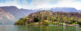 Villa in Lenno Como lake Italy with snow , tree and high mountain in panorama view