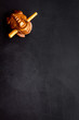 Buddhist symbol. Oriental wooden frog on black background top view space for text