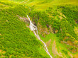 Waterfall in green mountains, Norway. - 249458120