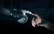 Leinwanddruck Bild - Robot hand making contact with human hand on dark background 3D rendering