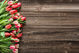Fototapeta Tulipany - Colorful spring tulip. Mothers day flowers on wooden background. © alicja neumiler