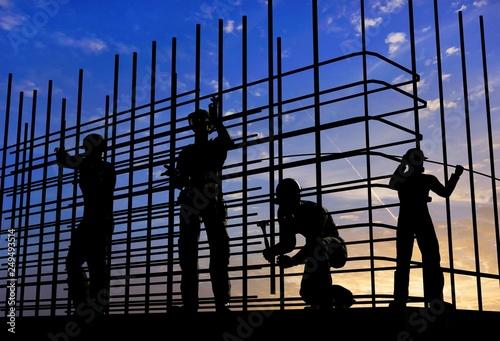 Leinwanddruck Bild Silhouette of the workers