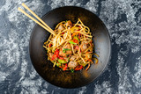 Udon stir-fry noodles with chicken meat and sesame in bowl - 249508182