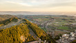 fog overt a city in the beautiful heart of austria with a great hill in the foreground, great sunrise in austria - 249513750