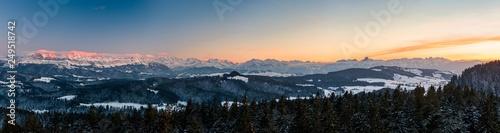 Leinwanddruck Bild winter sunset panorama of the Bernese Alps including Eiger Mönch Jungfrau, Niesen and Stockhorn