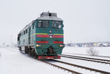 Locomotive moves by rail in the winter