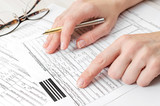 Woman filling health insurance claim form. Close up. - 249575377