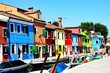Burano is an island in the Venetian Lagoon, northern Italy. It is situated near Torcello at the northern end of the Lagoon, and is known for it  brightly coloured homes.