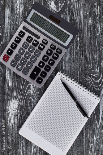 calculator, notebook and pen - 249586787