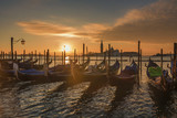 Venice sunrise and Venice gondolas on San Marco square at sunrise, Grand Canal, Venice, Italy