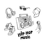 Hip-hop music set with boombox and various rapper style clothes and accessories.