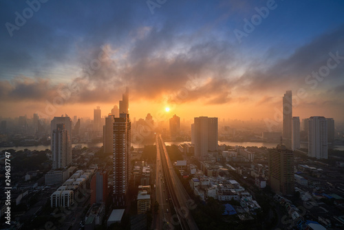 sunrise skyline with cityscape and bridge cross the river
