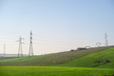 electricity pylons in field, photo as background - 249641534