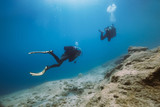 Two cuba divers diving underwater. - 249663159