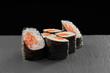 Sake maki sushi rolls with salmon.