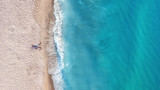 Vacation-image. Aerial view at people on beach. Sea and beach. Aerial view at sea and beach. Seascape from drone. Adventure and travel. Relax time on the beach