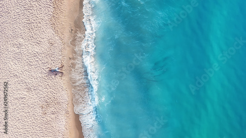 obraz PCV Vacation-image. Aerial view at people on beach. Sea and beach. Aerial view at sea and beach. Seascape from drone. Adventure and travel. Relax time on the beach
