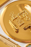 Gold items. Flat lay. Accessories on the table, woman desk top. View top table, background mock up. Envelope top - 249672903