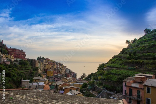 The small town of Manarola, which is located in the Cinque Terre national Park. Italian colorful town right by the sea. Beautiful evening sunset.