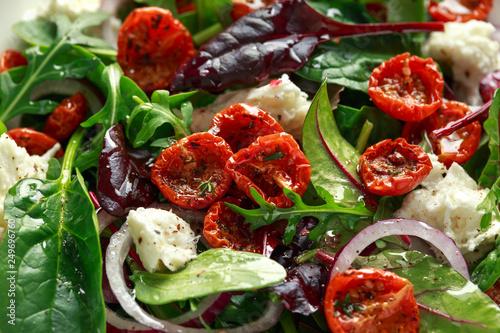Leinwandbild Motiv Sun dried tomatoes Salad with fresh vegetables mix and mozzarella cheese. healthy food. closeu up