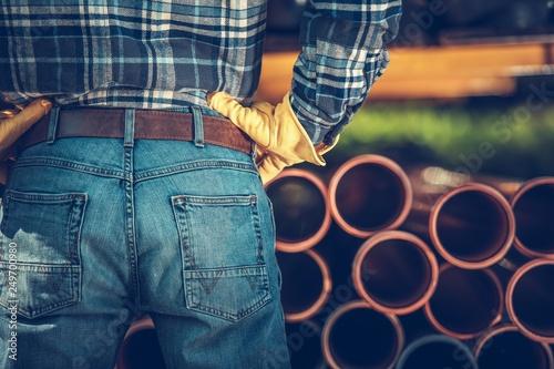 Men Choosing Septic Pipes - 249700980