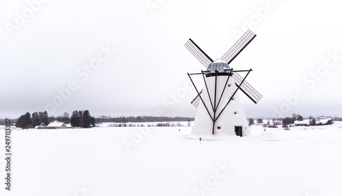 obraz lub plakat old windmill in a snowy field on Estonain countryside