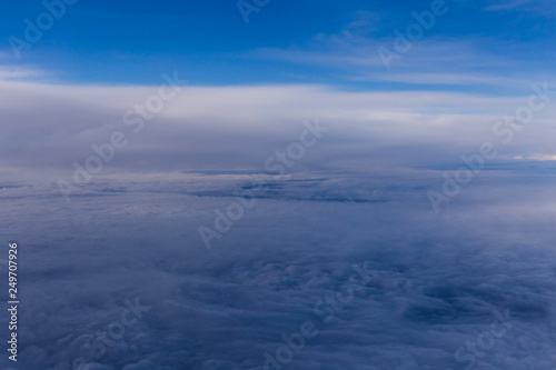 White clouds and blue sky from an airplane - 249707926