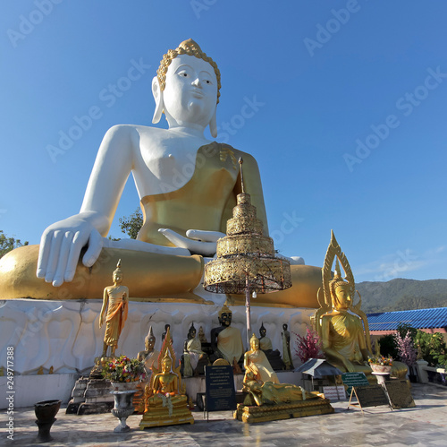 A Buddha Collection, Wat Phra That Doi Kham Temple, Chiang Mai, Thailand © Derrick Neill