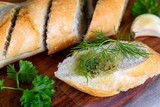 Fresh herb baguette with dill, parsley and garlic